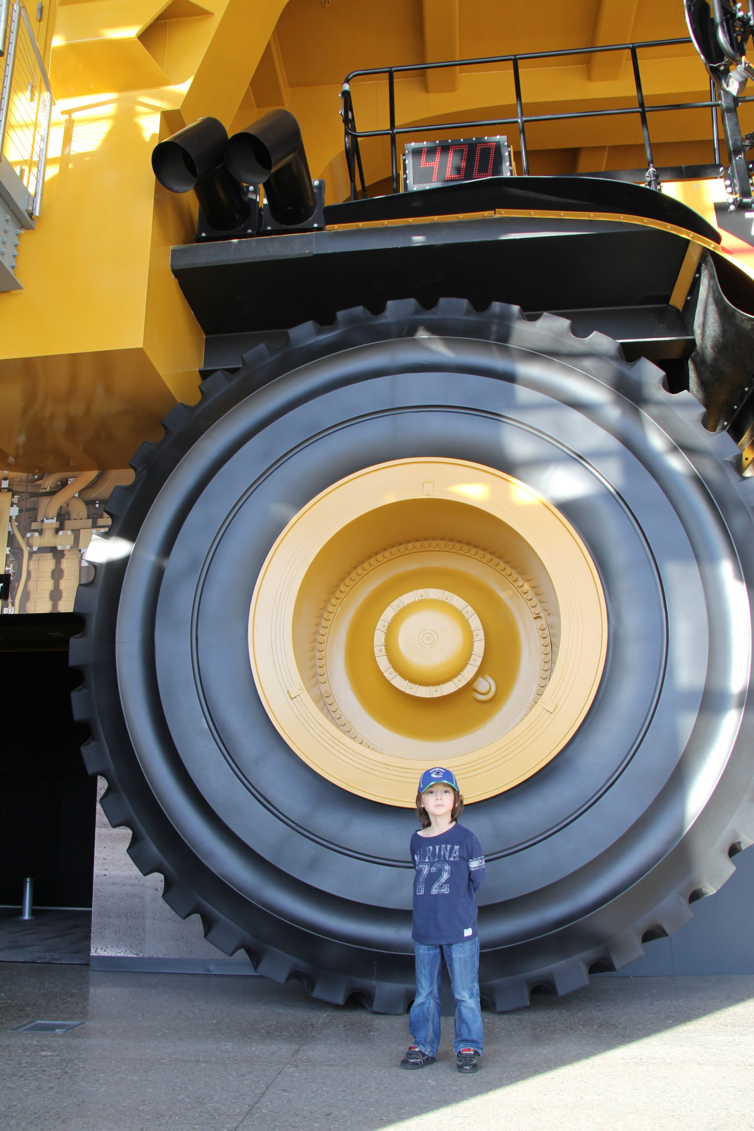 Seiji in front of a giant mining truck at the Caterpillar Visitor Centre in Peoria, Illinois.