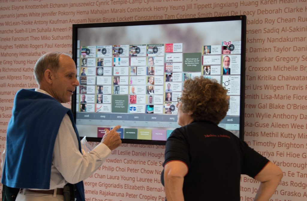 A conference attendee looking at Timeline with RCPA Executive Officer Debbie Deston.